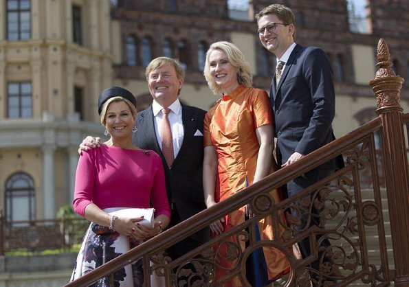 Queen Maxima wore NATAN floral skirt and pink top. Minister-President Manuela Schwesig and her husband Stefan in Schwerin