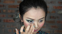 Sparkling Green New Year's Eve make up - For more pop long for the eyes, dap some shimmering powder on the tear duct with your ring finger.