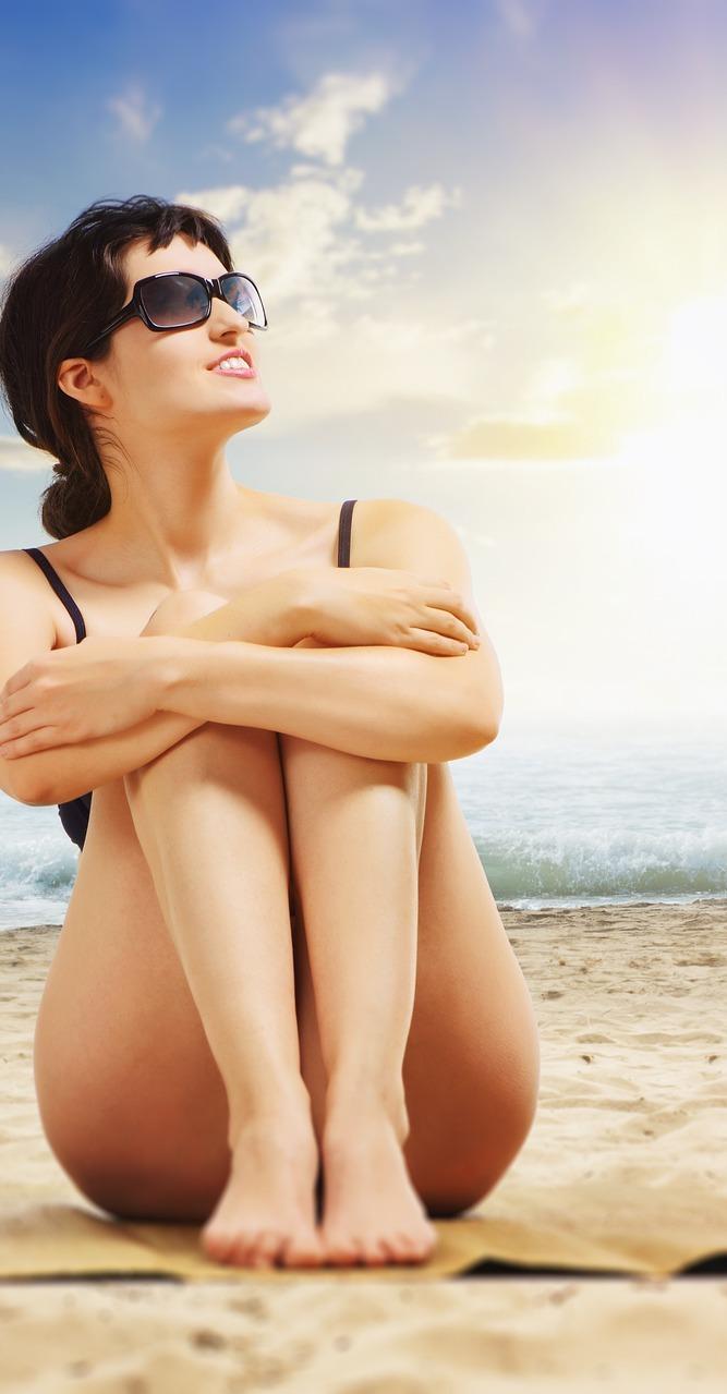 A lady on a beach.