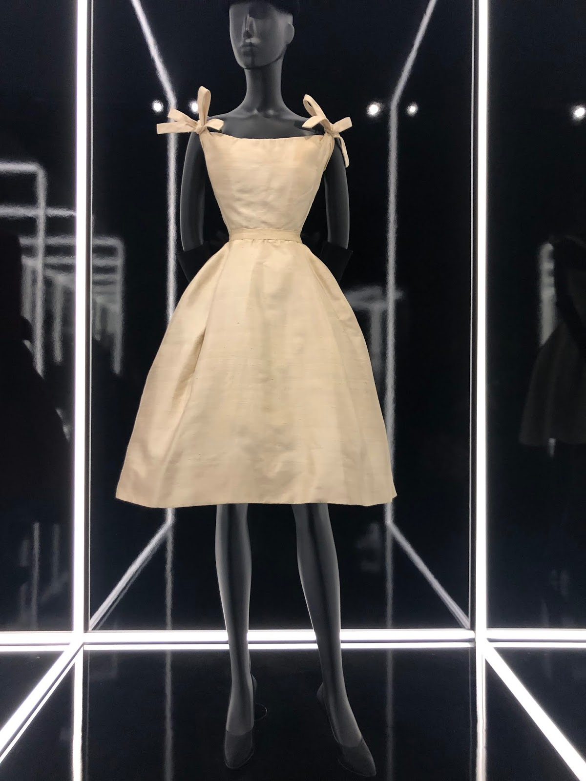 christian dior exhibition v and a white bow dress