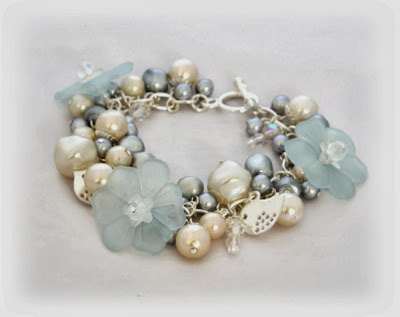 White & ice blue floral charm bracelet with tiny little silver bird charms handmade by Lottie Of London