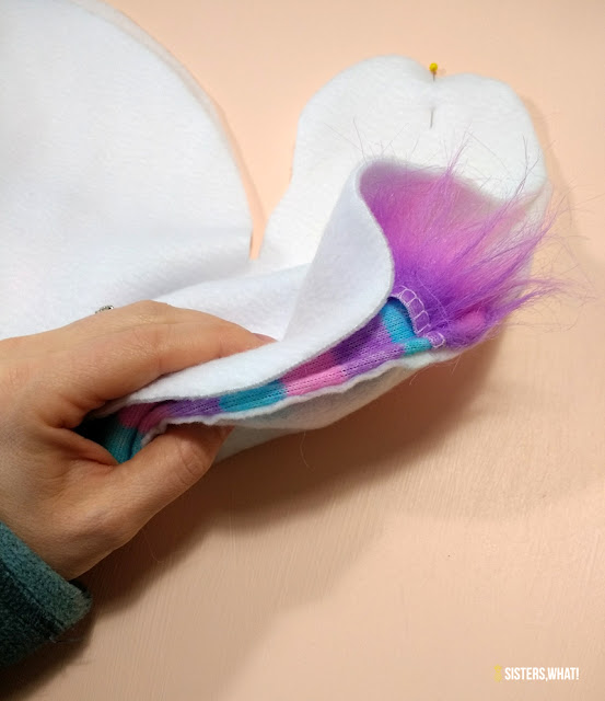 insert unicorn hair into unicorn toy