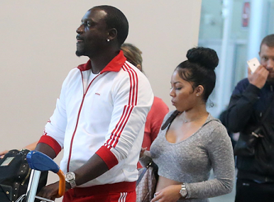 Akon steps out with one of his wives in France (photos)