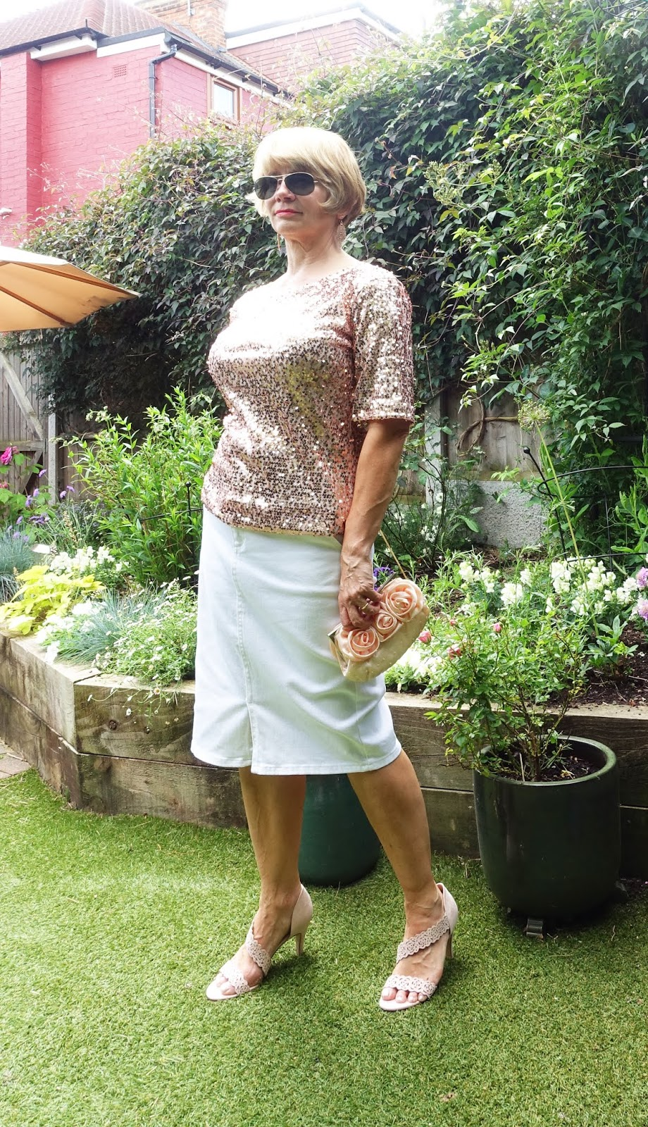 Image showing Is This Mutton? blogger wearing a rose gold sequin top and white denim skirt