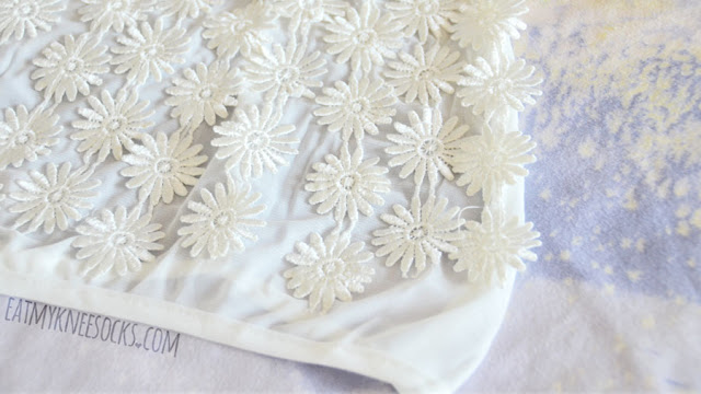Details on the white mesh floral applique embroidered halterneck crop top from Dresslink (a dupe of the For Love and Lemons Secret Garden bra).