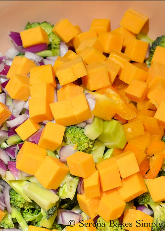 Best Broccoli Salad recipe with a cheddar cheese, sunflower seeds, and a light sesame seed dressing from Serena Bakes Simply From Scratch.