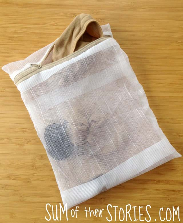 Learn how to make a delicates wash bag from an old net curtain. Repurposing tutorial by Sum of their Stories.