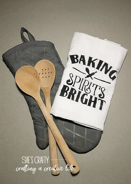 tea towel, oven mitt, wooden spoons