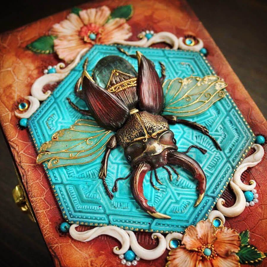 07-Stag-Beetle-Aniko-Kolesnikova-Animal-Fantasy-Journal-and-Book-Covers-www-designstack-co