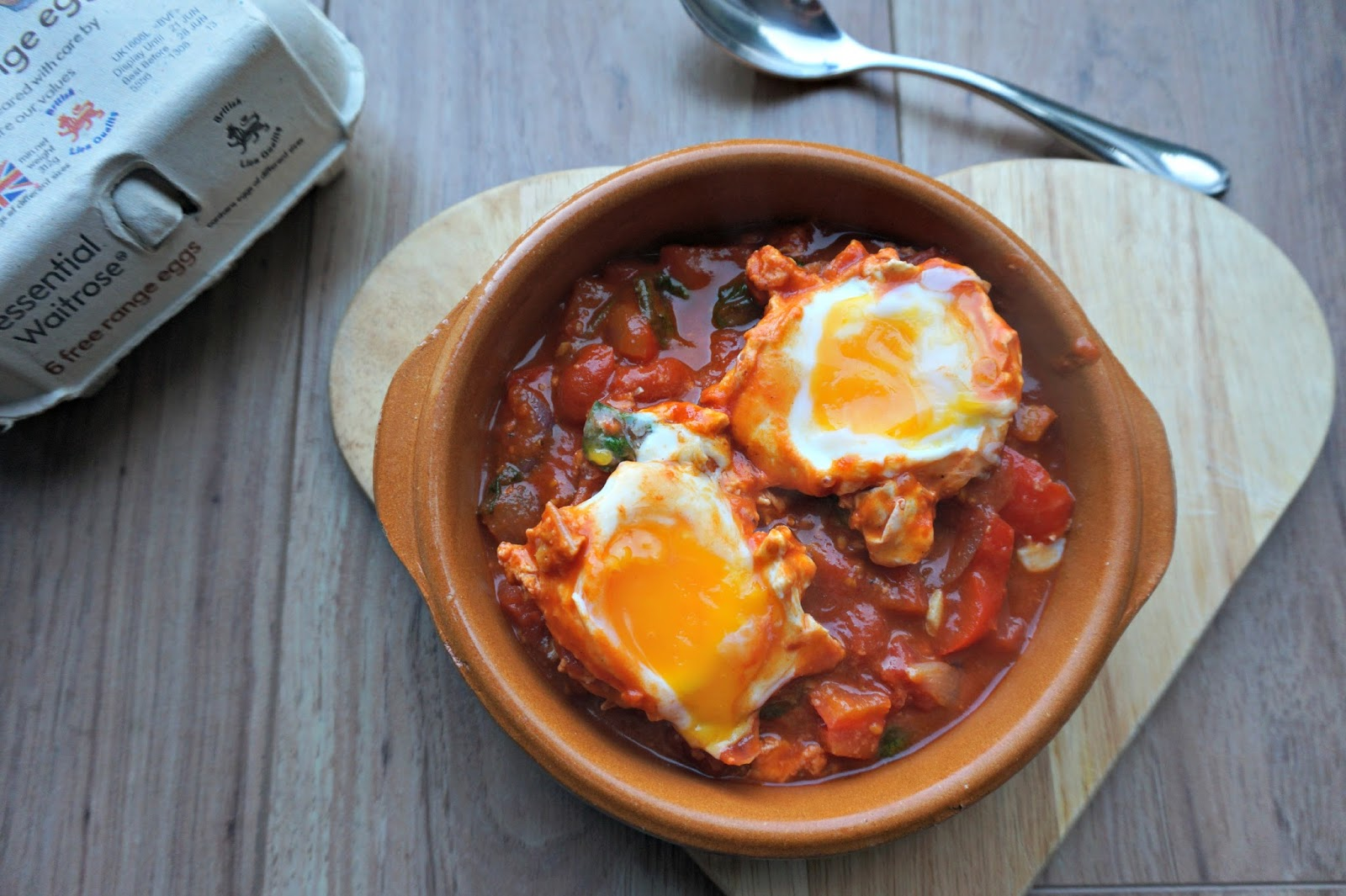 egg shakshuka in terracotta dish