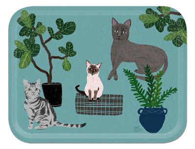 tray with sky blue background and pictures of three cats, plus some plants