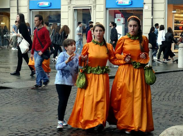 Girls in orange in Parma