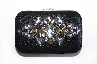 Bolso joya en negro, dorado y colores metalizados