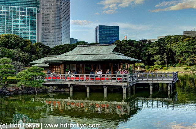 a traditional Japanese tea house on the seawater pond