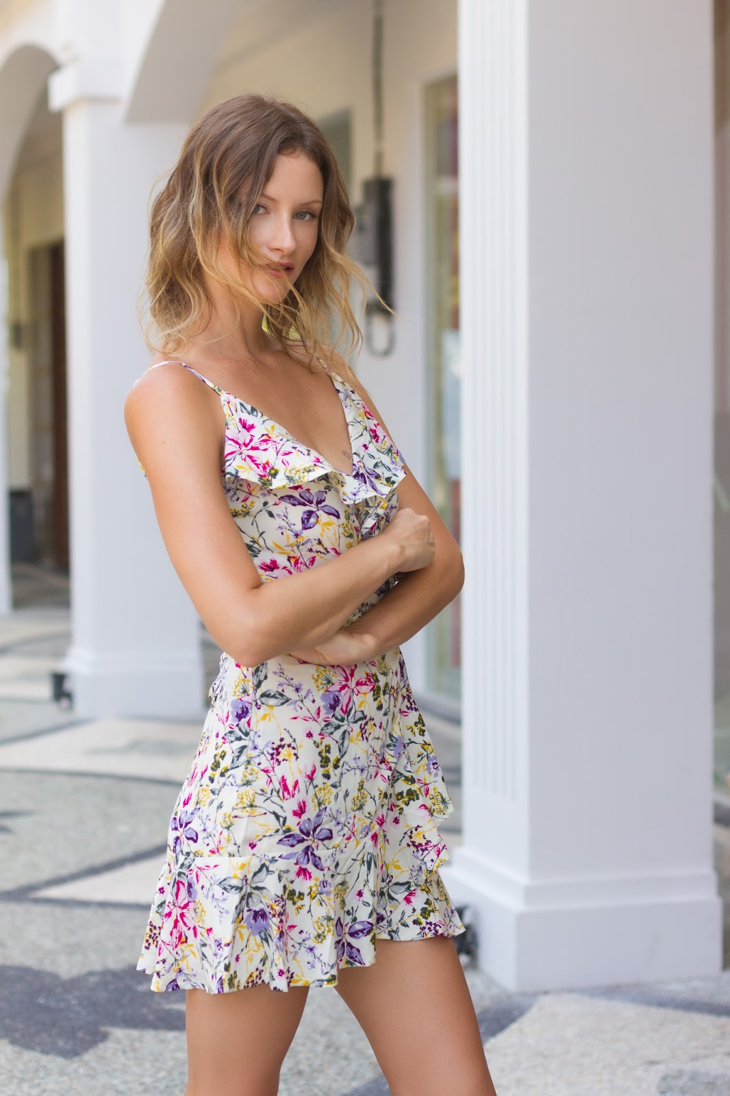 fashion designer and blogger, Alison Hutchinson, is wearing a KAYVALYA Raya Wrap dress in lemon