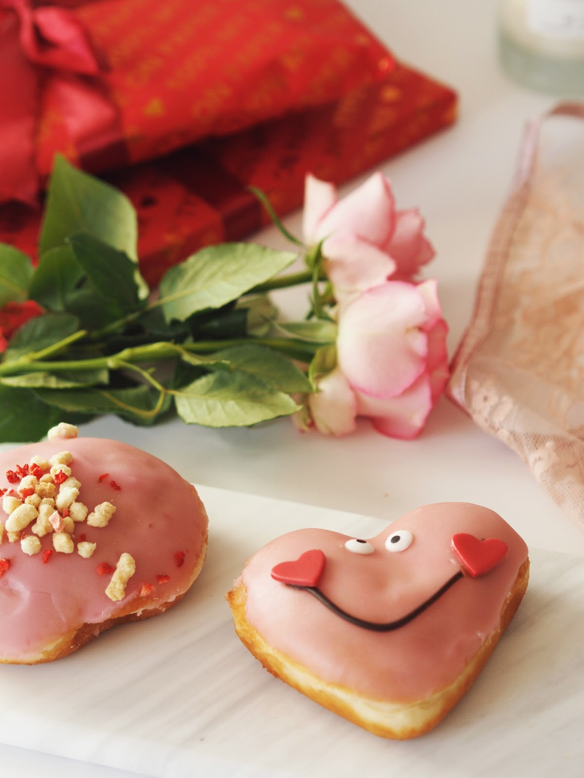 Cosy Valentines Flat Lay, Pink Krispie Kreme Doughnuts in a heart shape, red pretty gifted personalised wrapping paper, 100% my type on paper design