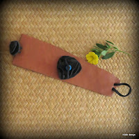 LoveLea's brown leather cuff with black leather flower.