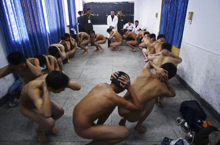 Youths undergo a medical examination during a People's Liberation Army Air Force recruitment campaign in Suining, in southwest China's Sichuan province.