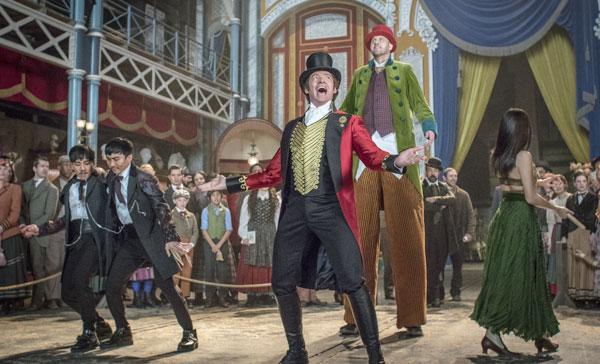 P.T. Barnum (Hugh Jackman) attracts his audience with his circus act in THE GREATEST SHOWMAN (2017)