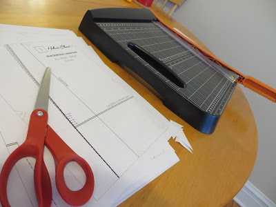 Scissors, printed PDF pattern for Helen's Closet Blackwood Cardigan, and Fiskars paper trimmer.