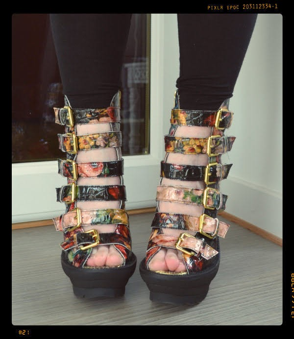 floral patent strappy shoes with rubber platform shown on the foot from the front
