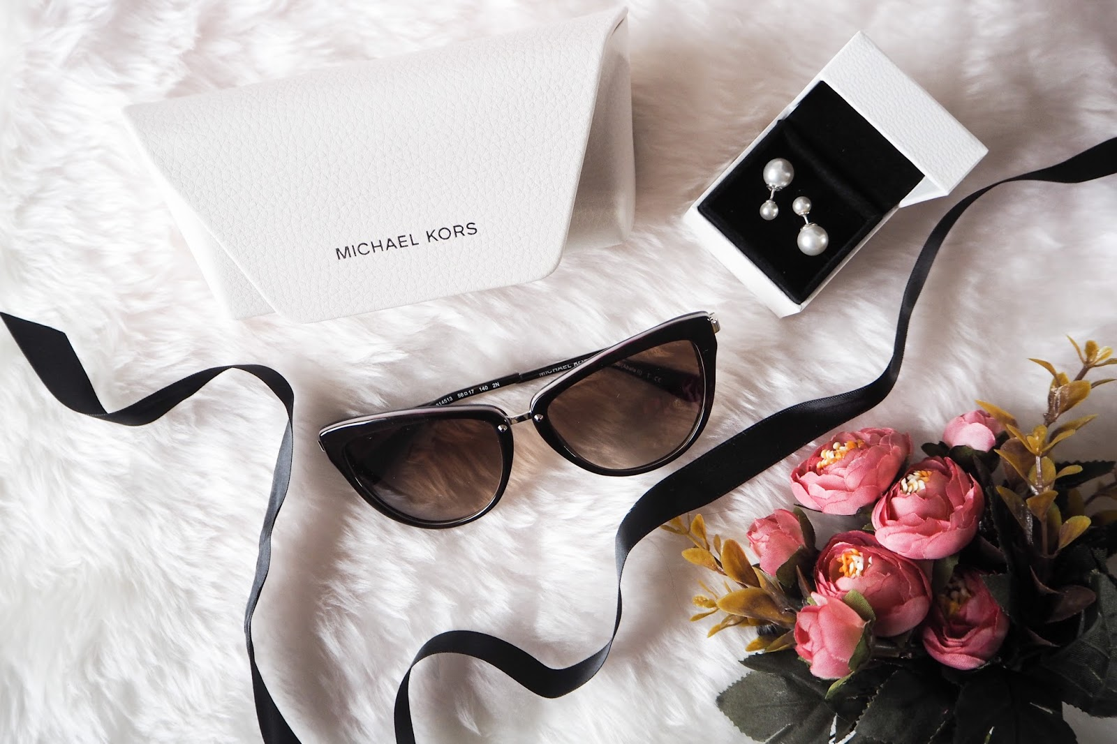 Flatlay of Discount Designer Sunglasses Michael Kors and Dior Tribal Earrings Dupe