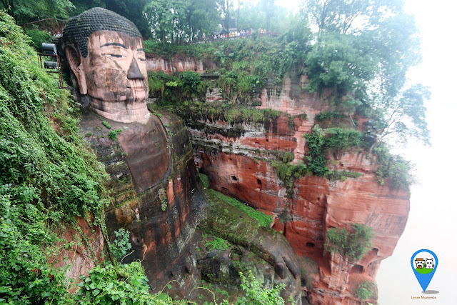 Standing on top of the mountain while admiring The Leshan Giant Buddha in Sichuan province of China