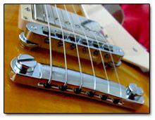 Ventajas y Desventajas de Pasar las Cuerdas de la Guitarra por Encima del Cordal