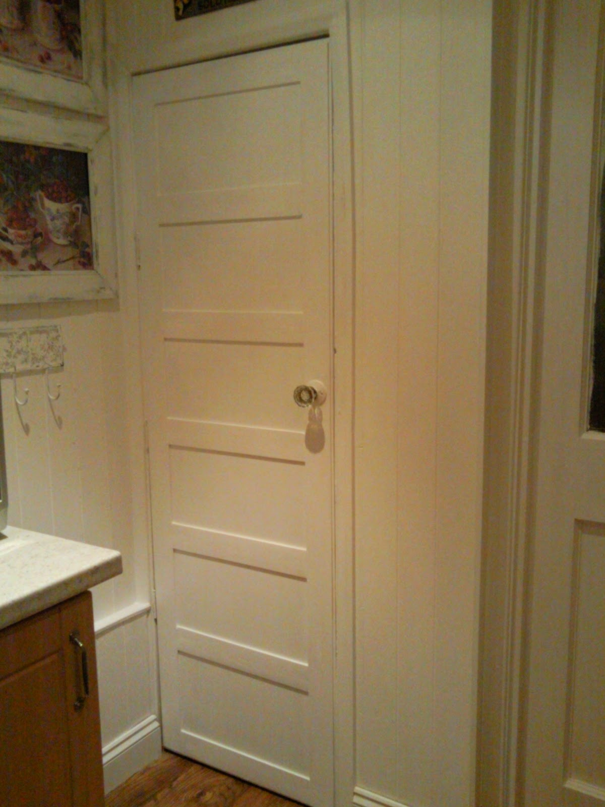3 paneled white door with glass knob