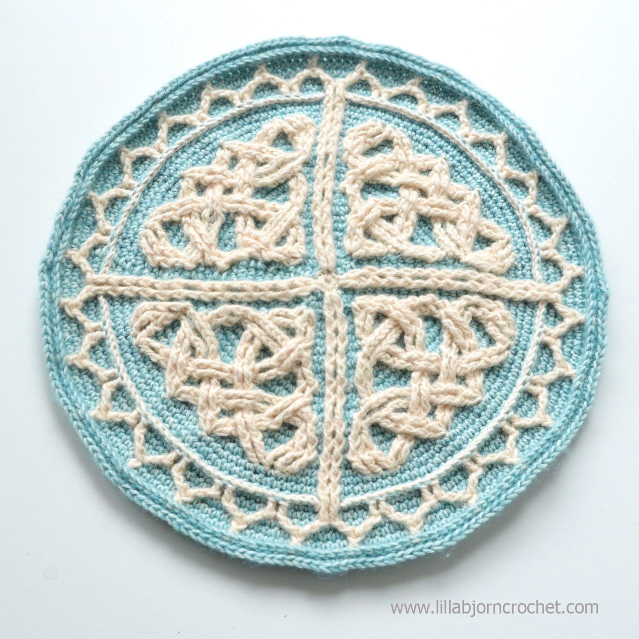 Celtic Cabled Mandala pattern can be used to make a round purse, chair pad, table decoration, wall haning and pillow throw. You name it! Original design by Lilla Bjorn Crochet