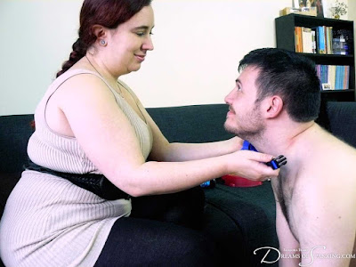 happy mistress with smile putting collar on her equally happy slave