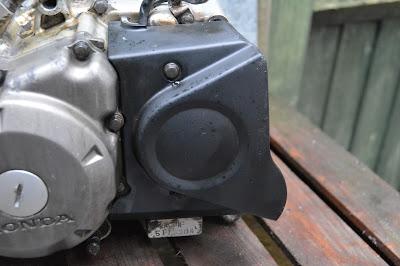 Honda CBR 125 R  Engine alternator generator stator side cover flywheel removal
