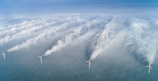 """The first picture of """"wake effects,"""" or turbulence that can reduce the power production from wind farms, was taken in 2008 by a pilot flying over an offshore wind farm near Denmark. (Credit: Vattenfall/NOAA) Click to Enlarge."""