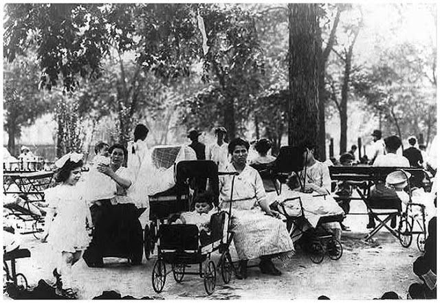 Mothers and children in a city park on a hot day. New York. Between 1908 and 1919.