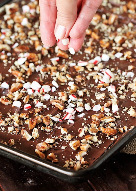 Sprinkling Crushed Candy Canes on Peppermint Saltine Cracker Toffee Image