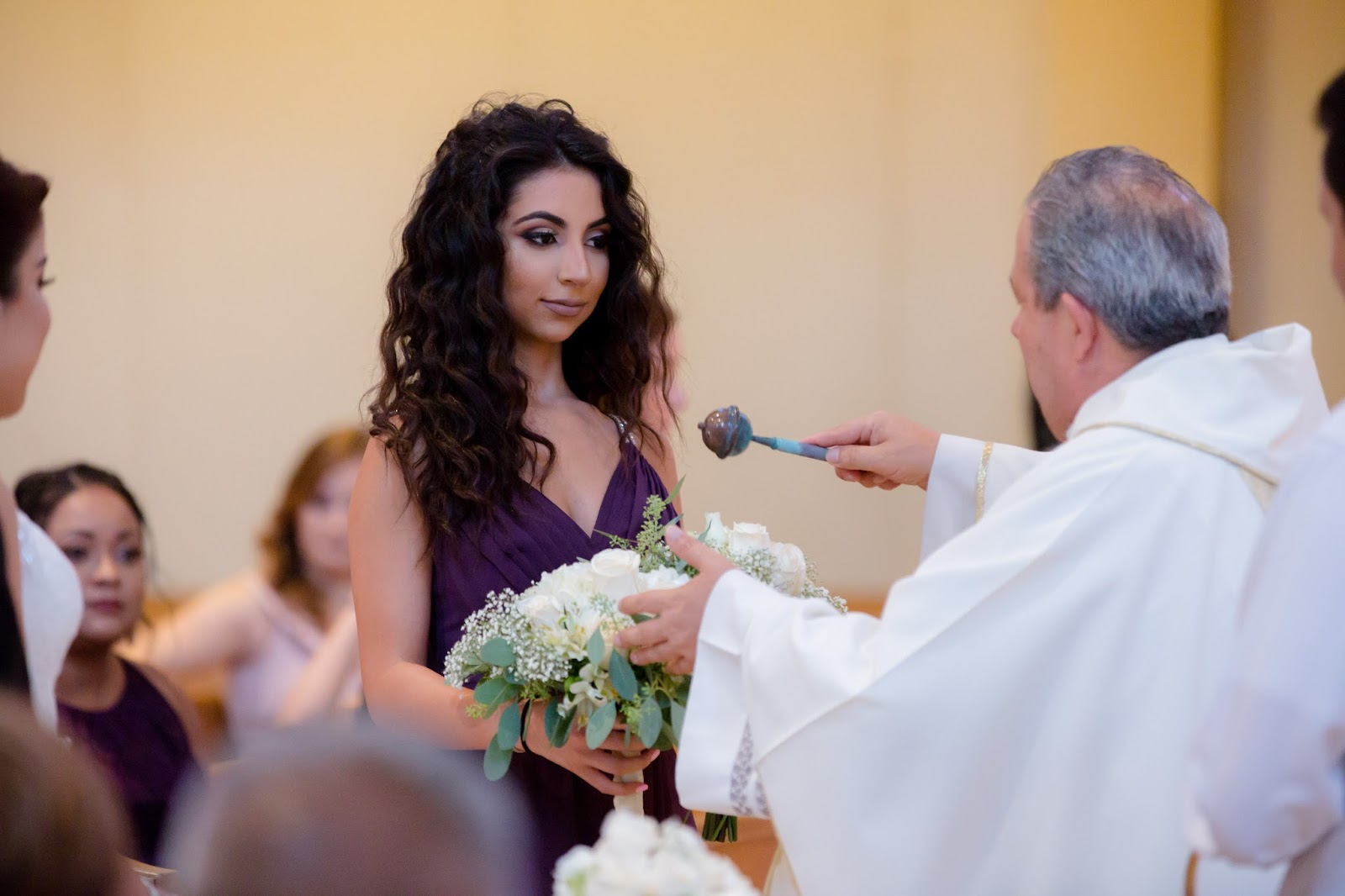 Priest Blessing a Bridesmaid and Bouquet