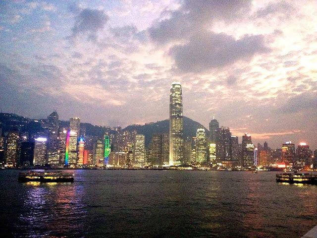 Hong kong lit up at night from across Victoria Harbour