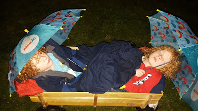 Just So Festival Two children sleeping in a trolley