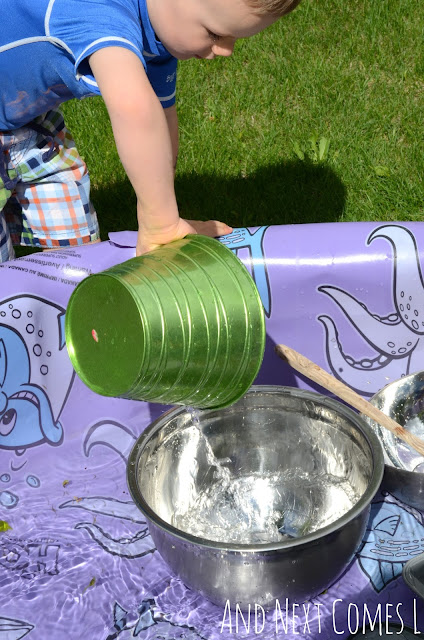 Child pouring water in a kiddie pool as part of a music science activity for kids