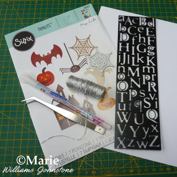 Tools materials to make a spiderweb banner craft Sizzix Halloween Thinlits dies alphabet glue pen cord