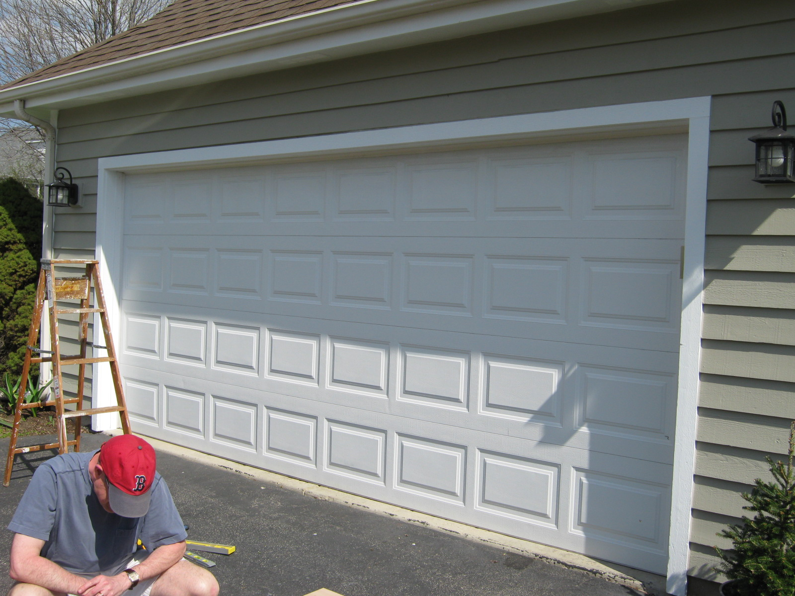 Garage door makeover garage door makeover kits coach for Coach house garage prices
