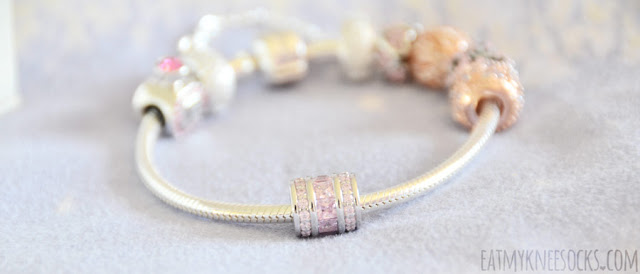 Details on the pink and rose gold sterling silver charm bracelet from Soufeel, a company specializing in crystal-embellished, engraved memorable charms and jewelry, offering a cheaper alternative to popular Pandora charm bracelets.