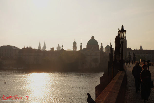 Dawn, the Charles Bridge in Spring Prague by Travel and Lifestyle Photographer Kent Johnson.