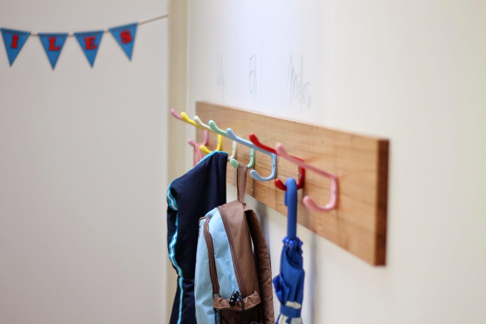living, loving, laughing   : a school bag hook wall