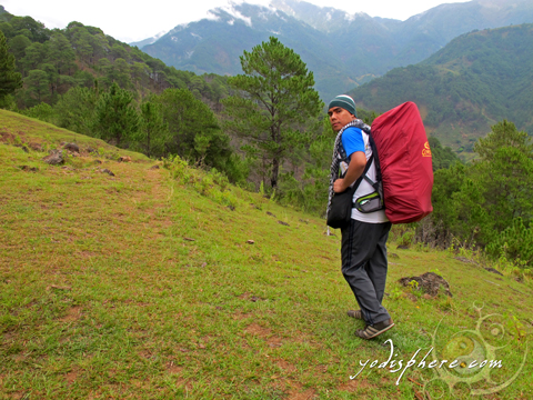 A mountaineer walking the initial Akiki trail going to Mt. Pulag