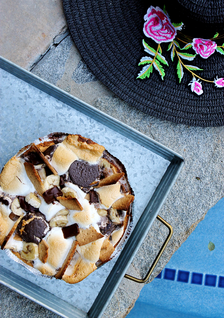 Pile a graham cracker pie crust high with sliced bananas, marshmallows, graham crackers, and chocolate- then grill directly on the grill top for 10 minutes to make thiese S'mores inspired dessert dip! #DoThe99 #99Obsessed #AD