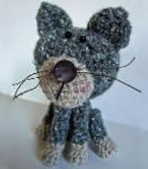 http://www.craftsy.com/pattern/crocheting/toy/peter-puss/20185