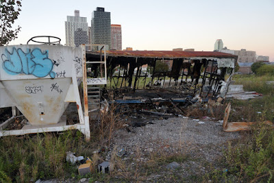 Burned out construction trailer in middle of abandoned tip of Hunter's Point