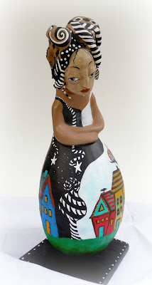 Rise Up an Original Gourd and Clay Art Doll for Women's Empowerment