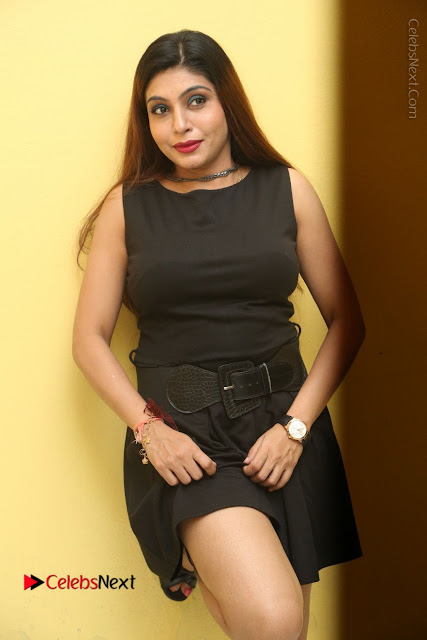 Tollywood Upcoming Actress Pooja Roshan Stills in Black Short Dress at Plus 1 Movie Trailer Launch  0164.JPG